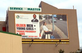 FILE - A giant billboard highlights the dangers for young women to have sex with older men. In South Africa.AIDS experts say cross-generational sex, especially among older men and younger women, is one of the reasons that African women bear a greater