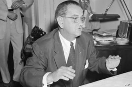 FILE - In this July 30, 1954, file photo, then-Sen. Lyndon Johnson, D-Texas, holds news conference in Washington. Moving on a campaign promise, President Donald Trump said Thursday, Feb. 2, 2017, he will work for the repeal of the Johnson Amendment t...