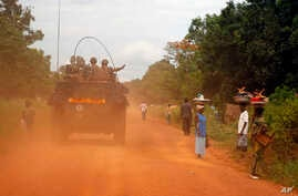 FILE - French forces are seen on patrol in Sibut, some 200 kilometers (140 miles) northeast of Bangui, Central African Republic, April 11, 2014.