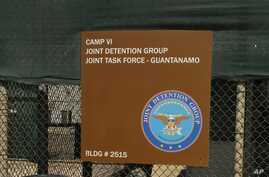 A sign for Camp 6 is posted outside the U.S. detention center at Guantanamo Bay, Cuba, Feb. 2, 2016. President Barack Obama has refused to send any suspected terrorists captured overseas to the detention center at Guantanamo Bay.