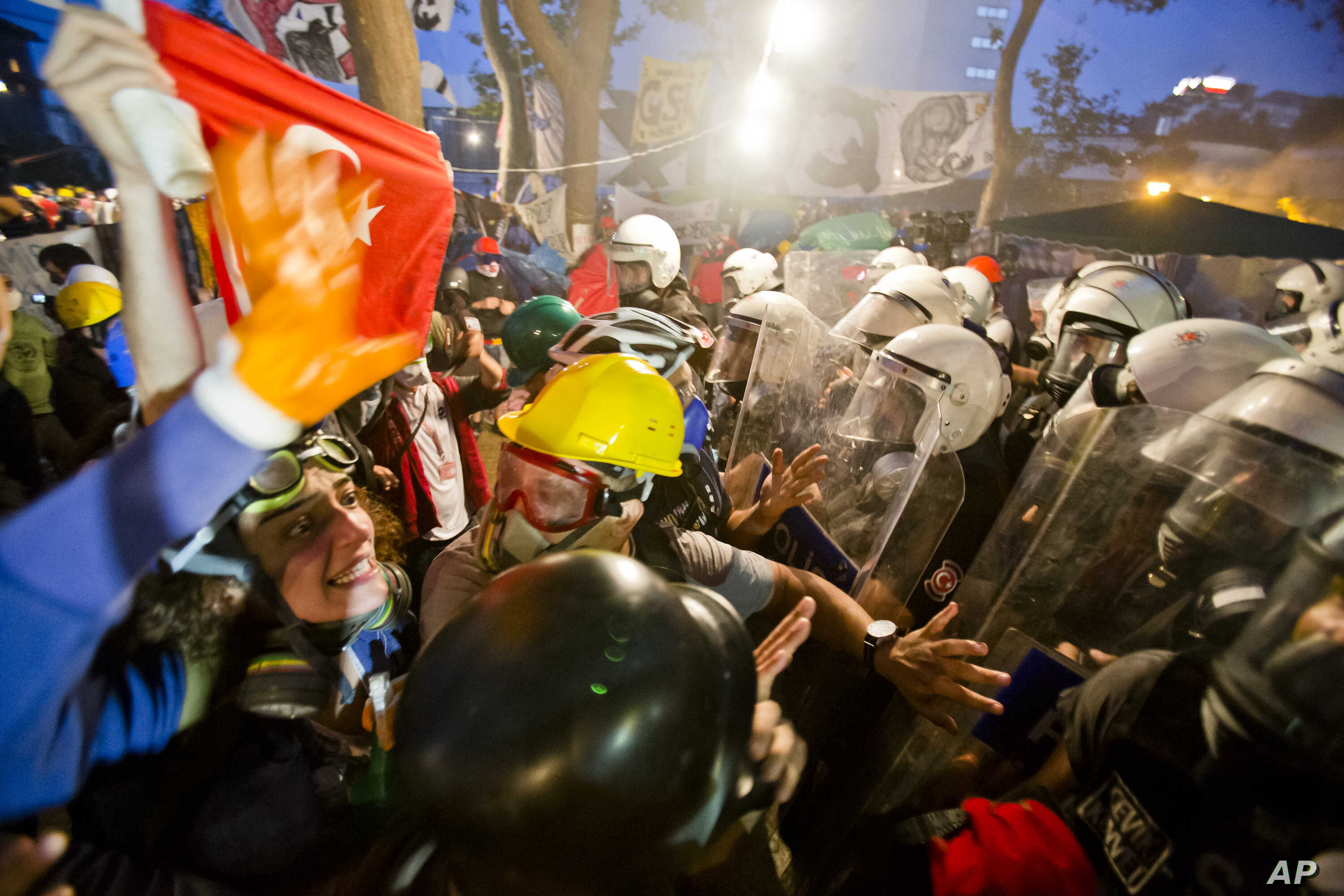 Protesters try to resist the advance of riot police in Gezi Park in Istanbul, Turkey, Saturday, June 15, 2013.