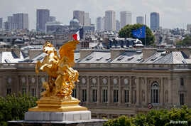 A view shows French and European flags flying half-mast at the Quai d'Orsay in Paris, France, July 28, 2014.