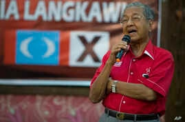 FILE - Former Malaysian strongman Mahathir Mohamad speaks at a local community in Langkawi, Malaysia, April 27, 2018. In an unlikely comeback, he's switched sides in Malaysian politics, coming out of retirement to unite an opposition that's seeking t
