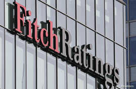 The Fitch Ratings logo is seen at their offices at Canary Wharf financial district in London, March 3, 2016.  Fitch is abandoning the Brexit assumptions it used to set Britain's credit rating.