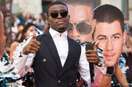 OMI arrives at the Much Music Video Awards, June 21, 2015, in Toronto, Canada.