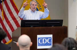 FILE - U.S. Sen. Rob Portman, R-Ohio, discusses efforts to increase health and safety for workers at a National Institute for Occupation Safety and Health (NIOSH) facility in Cincinnati, April 1, 2016.