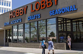 FILE - Customers enter and exit a Hobby Lobby store in Denver.