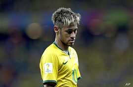 Brazil's Neymar looks down during the group A World Cup soccer match between Brazil and Mexico at the Arena Castelao in Fortaleza, Brazil, Tuesday, June 17, 2014. (AP Photo/Andre Penner)