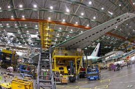 FILE - A Boeing 777 plane on the assembly line in Everett, Washington, June 12, 2017.
