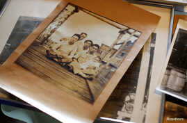 Family photos belonging to Takashi Odajima, who runs a seafood company manufacturing 'Shio-kara', a traditional fermented squid dish, and other seafoods, are seen at his family factory in Hakodate, on Japan's northern island of Hokkaido, July 19, 201