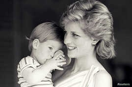 FILE PHOTO - Britain's Princess Diana holds Prince Harry during a morning picture session at Marivent Palace, where the Prince and Princess of Wales are holidaying as guests of King Juan Carlos and Queen Sofia, in Mallorca, Spain August 9, 1988.