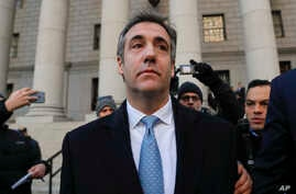 "Michael Cohen walks out of federal court Nov. 29, 2018, in New York, after pleading guilty to lying to Congress about work he did on an aborted project to build a Trump Tower in Russia. Cohen said he lied to be consistent with President Trump's ""poli"