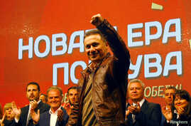FILE - Nikola Gruevski, former prime minister of Macedonia, greets suporters during a pre-election rally in Veles, Oct. 12, 2017. Gruevski, 47, was formally replaced as VMRO-DPMNE party leader on Dec. 23, 2017.