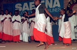FILE - Girls from a Rwandese refugees group dance late on the sidelines of the 30th anniversary of the Organization of African Unity refugee convention, in Dakar, Senegal.