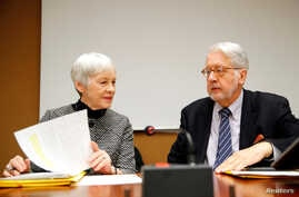 Paulo Pinheiro, Chairperson of the Commission of Inquiry on Syria, arrives with Karen Abuzayd, member of the Commission before the launch of their report on sexual and gender-based violence in Syria at the UN office in Geneva, March 15, 2018.