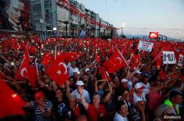Supporters of Muharrem Ince, presidential candidate of the main opposition Republican People's Party (CHP), wave flags during an election rally in Izmir, Turkey, June 21, 2018.