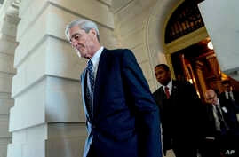 FILE - Former FBI Director Robert Mueller, the special counsel probing Russian interference in the 2016 election, departs Capitol Hill following a closed door meeting in Washington, June 21, 2017. A 2001 Justice Department memo warned that no nation,...