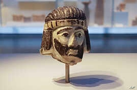 This June 4, 2018 photo shows a detailed figurine of a king's head, dating to biblical times, on display at the Israel Museum and found last year near Israel's northern border with Lebanon, in Jerusalem.