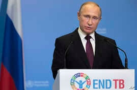 FILE - Russian President Vladimir Putin delivers his speech attending the World Health OrganiZation ministerial conference in Moscow, Russia, Nov. 16, 2017.