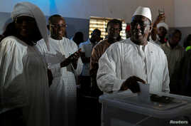 Senegal's President Macky Sall casts his vote at a polling station in Fatick, Senegal, Feb. 24, 2019.