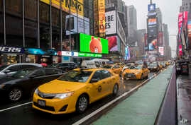 FILE - Traffic makes its way down Seventh Avenue in New York's Times Square, May 25, 2017. Cruise Automation, a self-driving software company owned by General Motors, said it would start testing in New York in early 2018.