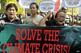 Protesters march toward the U.S. embassy on World Climate Day, Dec. 3, 2011.