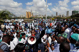 Ouma Oluga, Secretary-General of the Kenya Medical Practitioners, Pharmacists and Dentist Union (KMPDU), addresses doctors during a strike to demand fulfillment of a 2013 agreement between their union and the government that would raise their pay and