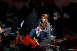 Civilians who escaped from Islamic State militants at Raqqa's front line rest at a mosque in Raqqa, Syria, Oct. 12, 2017.