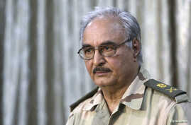 General Khalifa Haftar attends a news conference at a sports club in Abyar, east of Benghazi, May 17, 2014.