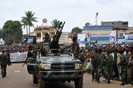 Rebel Seleka coalition soldiers arrive in Bangui, March 30, 2013. The Central African Republic's new strongman Michel Djotodia vowed Saturday not to contest 2016 polls and hand over power at the end of the three-year transition he declared after his