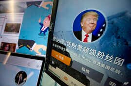 "Chinese fan websites for Donald Trump are displayed on a computer with the words ""Donald J. Trump super fan nation, Full and unconditional support for Donald J. Trump to be elected U.S. president"" in Beijing, China, May 18, 2016. China features promi..."