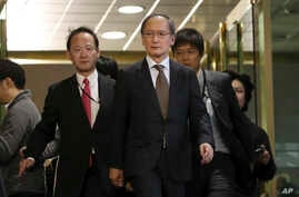 Japanese Ambassador to South Korea Yasumasa Nagamine, center, leaves after a meeting at the Foreign Ministry in Seoul, South Korea, Jan. 6, 2017.