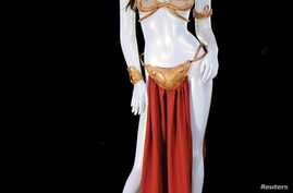 "The Princess Leia slave costume worn by actress Carrie Fisher in ""Star Wars Episode VI: Return of the Jedi"" is shown in this handout photo released to Reuters, Sept. 16, 2015."