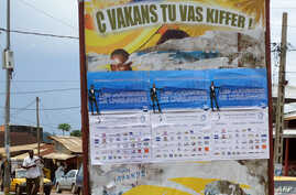 "FILE - A poster written in ""Camfranglais,"" a hybrid language mixing French, English and local languages, in seen in Yaounde, Cameroon, Oct. 20, 2010."