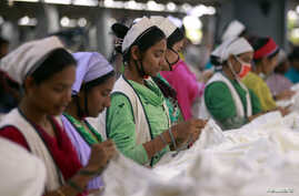 Women work at Goldtex Limited garment factory inside the Dhaka Export Processing Zone (DEPZ) in Savar, April 11, 2013.