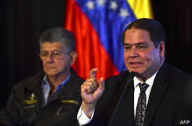 The president of the Foreign Affairs Committee of the Venezuelan National Assembly, Deputy Luis Florido (R), speaks during a press conference next to the president of the Venezuelan National Assembly, Henry Ramos Allup, in Caracas, Sept. 12, 2016.