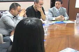 Investors from China meet in a conference room to discuss investment opportunities, green cards and other pertinent issues, in Lancaster, California, September 2011.