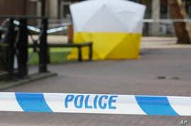 """A police tent covers the spot in Salisbury, Britain, March 6, 2018, where former Russian double agent Sergei Skripal and his daughter Yulia were found critically ill Sunday following a suspected exposure to an """"unknown substance."""""""