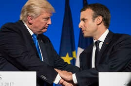 President Donald Trump and French President Emmanuel Macron shake hands at the conclusion of a joint news conference at the Elysee Palace in Paris, July 13, 2017.