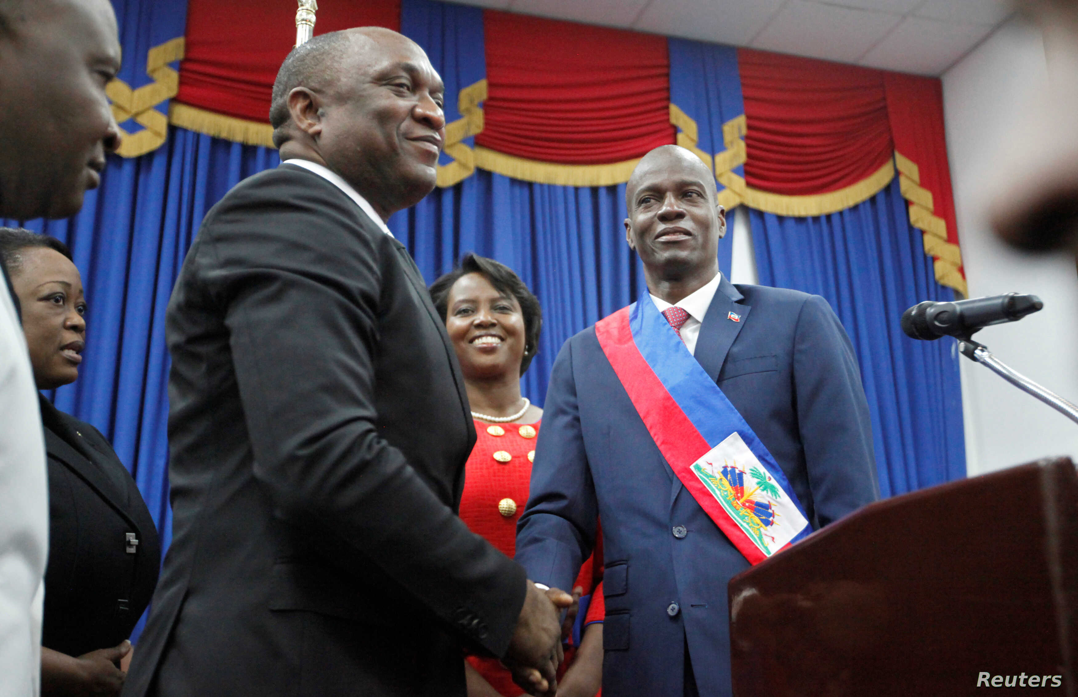 Haitian President Jovenel Moise shakes hands with the President of the Haitian Parliament Youri Latortue after receiving the presidential sash in Port-au-Prince, Haiti Feb. 7, 2017.