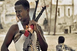 Somali government soldiers man a position near frontline of heavy clashes in northern Mogadishu, 11 Mar 2010