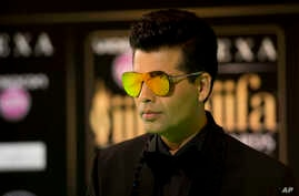 FILE - In this June 24, 2016, file photo, Bollywood film maker Karan Johar poses for photographers at the International Indian Film Academy (IIFA) Rocks Green Carpet for the 17th Edition of IIFA Weekend and Awards in Madrid, Spain.