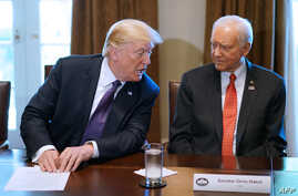 FILE - US President Donald Trump (L) speaks nex to Senate Finance Committee Chairman Orin Hatch, R-UT during a meeting with members of the the Senate Finance Committee and his economic team in the Cabinet Room of the White House in Washington, DC, on