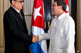 North Korea's Foreign Minister Ri Su Yong, left, shakes hands with Cuba's Foreign Minister Bruno Rodriguez during a photo opportunity before their meeting in Havana, Cuba, March 16, 2015.
