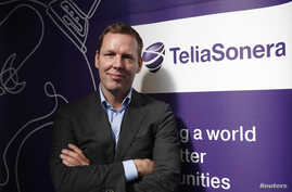FILE - TeliaSonera Chief Executive Johan Dennelind poses for a picture at the Mobile World Congress in Barcelona, Feb. 25, 2014.