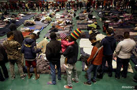 Migrants from Central America line up for food at an improvised shelter in Ciudad Juarez, Mexico Feb. 21, 2019.
