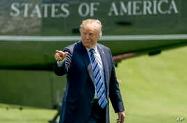 """President Donald Trump points to members of the media as he arrives on the South Lawn of the White House in Washington, May 25, 2018. Trump accused The New York Time of using a """"phony source"""" who turned out to be a White House official briefing sever"""