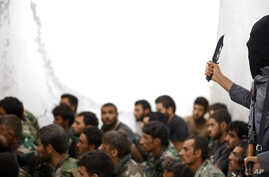 FILE - This undated file photo posted on Wednesday, Aug. 27, 2014 by the Raqqa Media Center of the Islamic State group, a Syrian opposition group, which has been verified and is consistent with other AP reporting, shows a fighter from the Islamic Sta