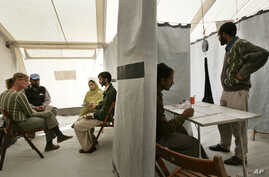 FILE - A man from the Pakistani Kashmiri village of Dak talks about his earthquake experiences during a psychotherapy session with psychologists of the MSF medical charity, at a tent clinic in the town of Bagh, Oct. 29, 2005.