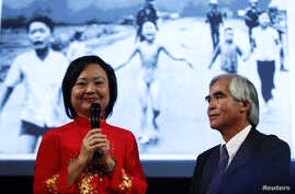 Photojournalist Nick Ut and Kim Phuc (L) attend the presentation of the latest Leica equipment at Photokina 2012, the world's largest fair for imaging, in Cologne September 17, 2012.